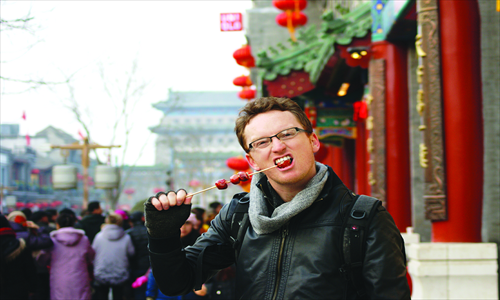 3. Eating Beijing snack tanghulu (candied haws) in the heart of Qianmen