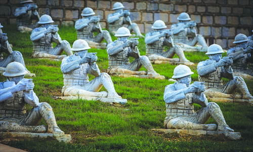Sculptures of CEF soldiers are displayed at the memorial park on Songshan Mountain. Photo: IC