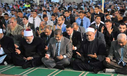 This photo provided by the Egyptian Presidency shows Egyptian president Mohamed Morsi (3rd, L) prays at a mosque in his hometown of Zagazig, Egypt, July 20, 2012. In Egypt, Ramadan began on Friday.