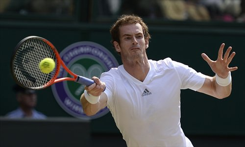 Andy Murray returns against Novak Djokovic during the men's singles final at the 2013 Wimbledon Championships on Sunday. Photo: AFP