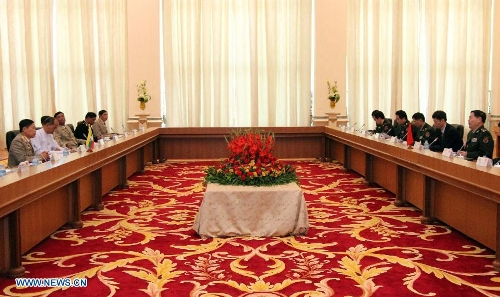 Representatives from China and Myanmar hold a meeting in Nay Pyi Taw, capital of Myanmar, on Jan. 20, 2013. Deputy Chief of General Staff of the Chinese People 's Liberation Army Qi jianguo arrived here Saturday for the first China-Myanmar strategic security consultation. (Xinhua/U Aung)