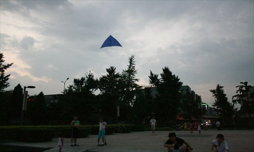 Main: A kite monitoring air quality flies over Deshengmen.