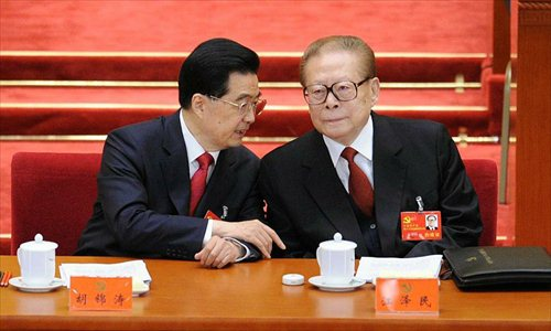 Hu Jintao (L), general secretary of the Central Committee of the Communist Party of China (CPC) and Chinese president, talks with Jiang Zemin, former general secretary of the CPC Central Committee and former Chinese president, during the opening ceremony of 18th CPC National Congress at the Great Hall of the People in Beijing, capital of China, Nov. 8, 2012. The 18th CPC National Congress opened in Beijing on Thursday. Photo: Xinhua