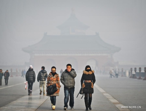 Visitors walk at the fog-enveloped Temple of Heaven in Beijing, capital of China, Jan. 12, 2013. Heavy fog hit Beijing on Saturday. (Xinhua/Li Wen)