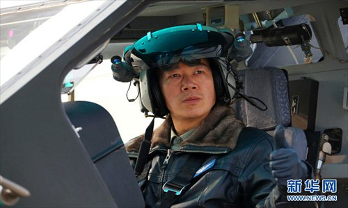 Cheng Jianzhong, chief of staff of an army aviation brigade under the Nanjing Military Area Command (MAC) of the Chinese People's Liberation Army (PLA), is China's first batch of super-level pilots of WZ-10, first batch of all-weather pilots of WZ-10, and also the first batch of pilots who completed the fire test with WZ-10's all kinds of weapon systems. (Xinhua/Guo Weihu)