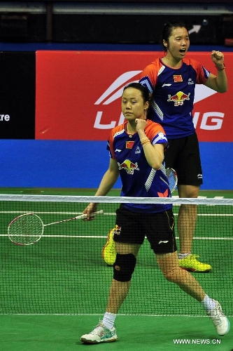 Zhao Yunlei (front) and Tian Qing of China react during their women's doubles finals against Misaki Matsutomo and Ayaka Takahashi of Japan in the Singapore Open badminton tournament in Singapore, June 23, 2013. Zhao Yunlei and Tian Qing won 2-0. (Xinhua/Then Chih Wey)