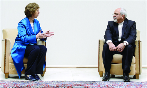 EU foreign policy chief Catherine Ashton (left) speaks with Iranian Foreign Minister Mohammad Javad Zarif prior to the start of nuclear talks on Tuesday at the United Nations offices in Geneva. Photo: AFP