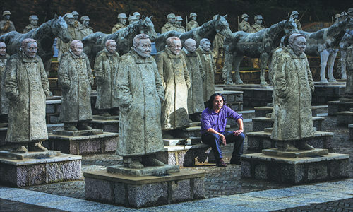 Chinese sculptor Li Chunhua sits among his sculptures of soldiers from the China Expeditionary Force (CEF) at a memorial park on Songshan Mountain in Longling county, Yunnan Province. Photo: IC