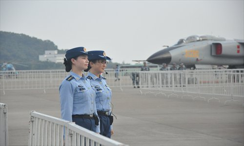 Two People's Liberation Army Air Force soldiers guard a Xi'an JH-7A fighter bomber in Zhuhai, Guangdong Province Sunday. The air force sent at least nine China-made combat aircraft to Airshow China 2012. Photo: GT/Xu Tianran