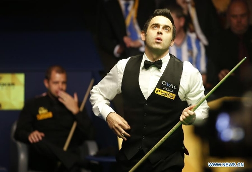 Ronnie O'Sullivan of England reacts during the final of 2013 World Snooker Championship at the Crucible Theatre in Sheffield, Britain, May 6, 2013. Ronnie O'Sullivan seals his fifth world title by defeating Barry Hawkins of England with 18-12 in the final.(Xinhua/Wang Lili)