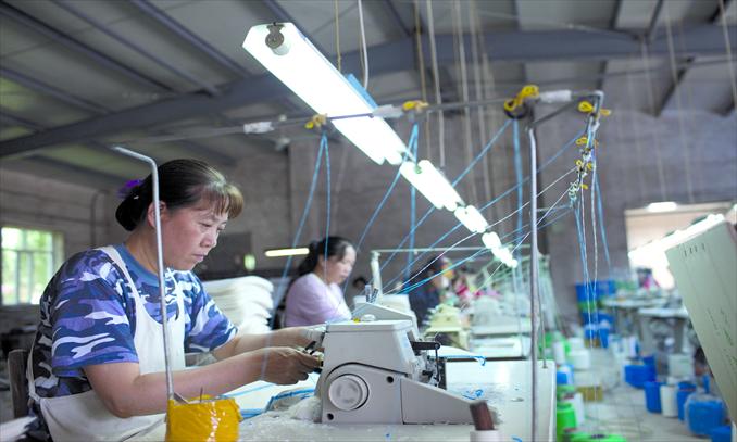 Women work in a textile processing plant in Tumen, Yanbian Korean Autonomous Prefecture, Jilin Province. Photo: CFP