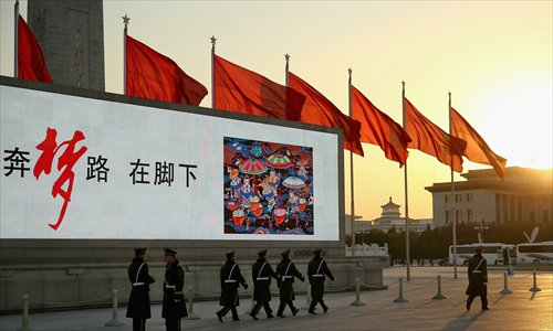 Red flags billow outside the Great Hall of the People in central Beijing where the Communist Party of China Central Committee gathered for a plenum on November 12. Photo: CFP