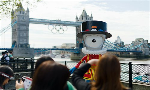 Olympic mascot Beefeater Mandeville is displayed on a footpath on the banks of the river Thames in central London on July 22, 2012.Photo: AFP
