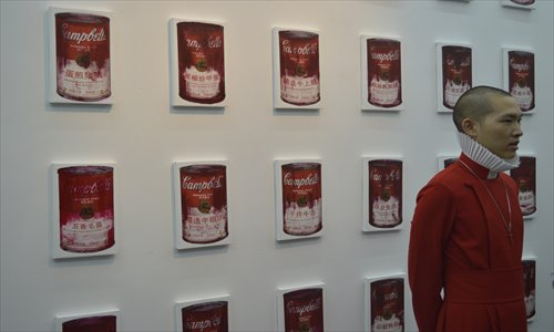 Artist Mei Le poses in front of his artwork <em>Campbell Soup Special for China</em> series. Photos: Courtesy of Moproo