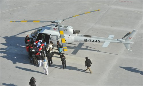 The Beijing Red Cross Emergency Rescue Center assigned a helicopter to transfer an injured Swedish boy from Zhangjiakou to Beijing on January 3 this year. Photo: CFP
