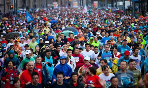 Runners participate in the annual Shanghai International Marathon on December 2.  More than 30,000 runners participated in the annual Shanghai International Marathon Sunday, the most in the marathon's 17-year history, according to organizers. Photo: Cai Xianmin/GT