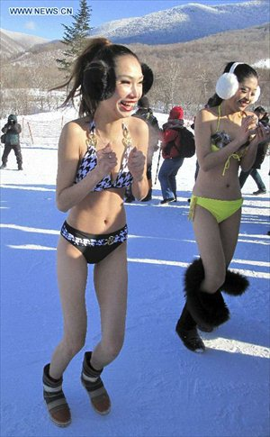 Models present bikini collections during a ski performance held in Beidahu ski resort of Jilin City, northeast China's Jilin Province, December 31, 2012. Some 40 models in G-strings and bras shivered from the cold as they showed off on snow-covered slopes in the ski resort to promote the event.Photo: Xinhua