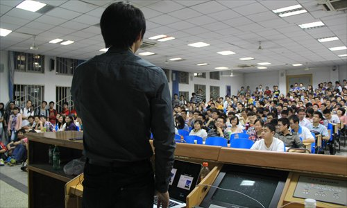 Students from Huazhong University of Science and Technology attend a speech about college life on May 19 in Wuhan, Hubei Province. Photo: IC