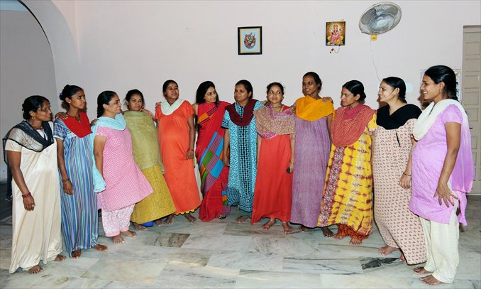 Indian surrogate mothers pose with Dr Nayna Patel (sixth from left) at a
