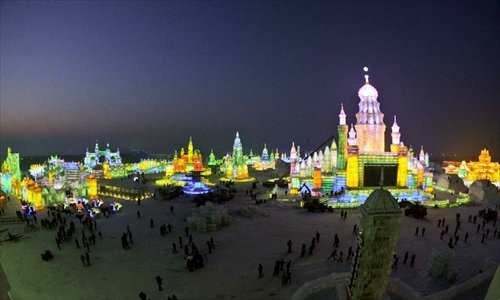 Photo taken on December 23, 2012 shows the night scene of the 29th Harbin International Ice and Snow Festival in Harbin, capital of northeast China's Heilongjiang Province. The festival kicked off at the Harbin Ice and Snow World on Sunday. Photo: Xinhua
