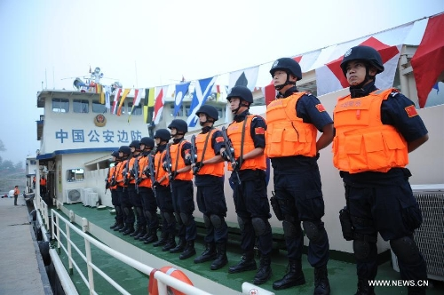 Chinese policemen are fully prepared to start off to carry out the joint anti-drug campaign on the Mekong River at the Guanlei Port in Xishuangbanna, southwest China's Yunnan Province, April 20, 2013. It is the ninth joint action of China, Laos, Myanmar and Thailand since a joint statement on the river's safety by the four nations dated Oct. 31, 2011. The Mekong river is a major Southeast Asian trading route, where narcotics crimes continue to rage. (Xinhua/Wang Dingbin)