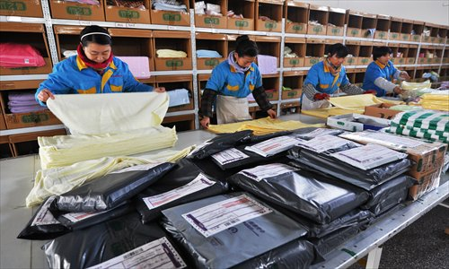 Workers pack products to be delivered for online orders in Zouping, East China's Shandong Province, on Thursday. Photo: CFP