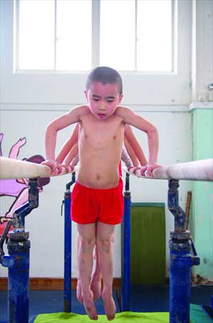 Boys on the parallel bars. Photo: Cai Xianmin/GT