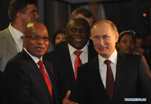 South African President Jacob Zuma(L) greets Russian President Vladimir Putin(R) upon his arrival at International Convention Centre (ICC) in Durban, southeastern port city of South Africa on March 26, 2013. South Africa will host the Fifth BRICS Summit from March 26 to 27, 2013, at the Durban International Convention Center (ICC). (Xinhua/Chang Lin)(gy)
