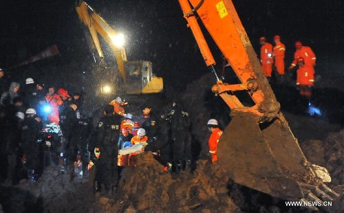 Rescuers and excavators work at the mud-inundated debris after a landslide hit Gaopo Village in Zhenxiong County, southwest China's Yunnan Province, Jan. 11, 2013. The death toll from a landslide that hit Gaopo Village on Friday has risen to 42, after more bodies were retrieved. Two injured people have been sent to a nearby hospital, and it has been confirmed that their injuries are not life-threatening. (Xinhua/Chen Haining)