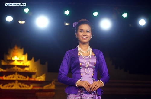 A model presents traditional costumes during the Myanmar women's traditional culture and dressing style show at the National Theater in Yangon, Myanmar, June 29, 2013. The show was held here in commemoration of Myanmar Women's Day falling on July 3. (Xinhua/U Aung)