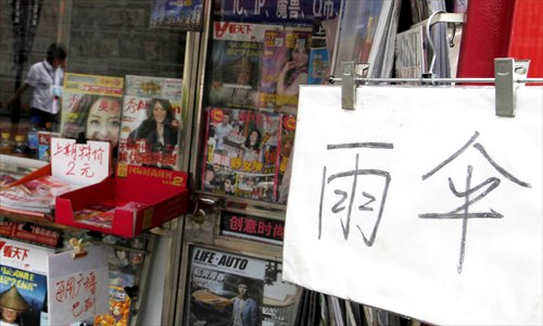 This stand is now selling umbrellas as well as newspapers and magazines.Photo: Yang Hui/GT
