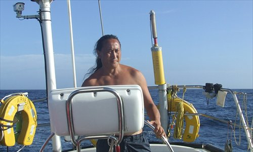 Zhai Mo out on the water with his boat. Photo: Courtesy of Zhai Mo