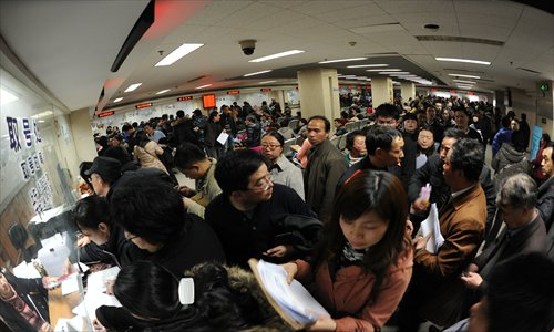 Residents of Nanjing in Jiangsu Province crowd in a real estate transaction center. The State Council unveiled new policies aiming to further rein in sky-high housing prices, prompting home owners in major cities to sell their houses before the measures take effect. Photo: CFP