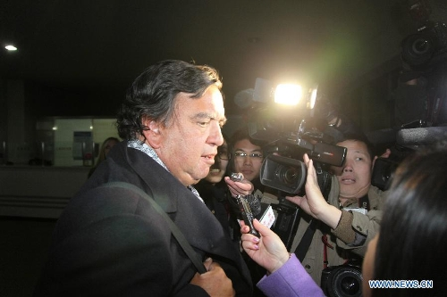U.S. Former New Mexico state governor Bill Richardson answers questions from the press after arriving at Sunan airport of Pyongyang, the Democratic People's Republic of Korea (DPRK), on Jan. 7, 2013. Bill Richardson and Eric Schmidt arrived here on Monday for a