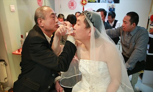 A gay couple pictured before their wedding was interrupted at a venue in Pinggu district Wednesday. Photo: CFP