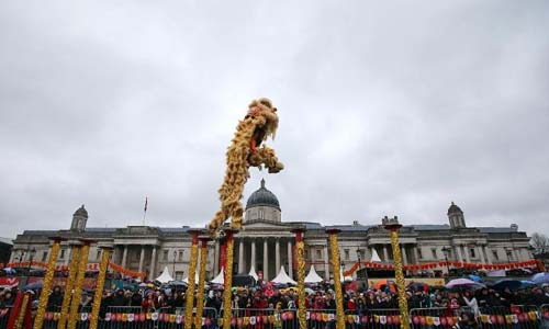 People perform lion dance during a celebration marking the Chinese Lunar New Year at Trafalgar Square in London, Britain, on Feb. 10, 2013. Photo: Xinhua