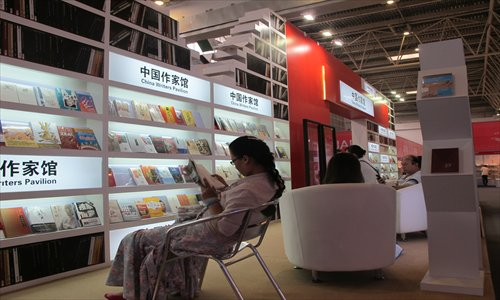 A woman reading in the Chinese Writers Pavilion at BIBF