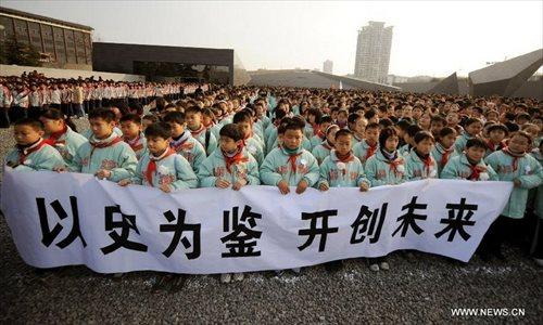 Rally Commemorates 1937 Memorial Day Massacre: China Mulls Nanjing Massacre Memorial Day