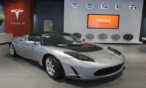 A Tesla Roadster electric sports car is displayed at a showroom in California. Photo: IC