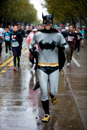 A runner wearing a Batman costume participates in the annual Shanghai International Marathon on December 2.  More than 30,000 runners participated in the annual Shanghai International Marathon Sunday, the most in the marathon's 17-year history, according to organizers. Photo: Cai Xianmin/GT