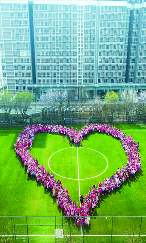 Students gather on the field of the Canadian International School on April 2 dressed in pink to commemorate Pink Shirt Day. Pink is the international anti-bullying color. Photo: Li Hao/GT