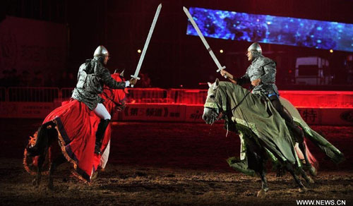 Horsemen stage an equestrian performance at the opening ceremony of the second Ordos Dalate International Horse Culture Festival in Dalate Banner of Ordos, north China's Inner Mongolia Autonomous Region, August 25, 2012. Some 60 horsemen from 15 countries and regions gave performances at the festival's opening ceremony Saturday night. Photo: Xinhua