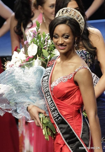 Camille Munro from Regina, Saskatoon was crowned to be Miss World Canada 2013 at River Rock Show Theatre in Richmond, Canada, May 9, 2013. Winning contestant Camille Munro will represent Canada in Miss World 2013 Final, to be held in Jakarta, Indonesia September 28.(Xinhua/Liang Sen)