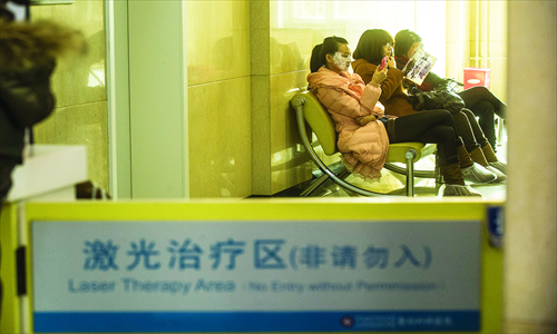 Young women sit in the waiting room at the Plastic Surgery Hospital, China Academy of Medical Science, in Shijingshan district on Thursday. Photo: Li Hao/GT