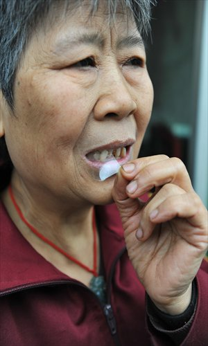 Chew On Glass.Chongqing Senior Citizen Known For Chewing Up Glass Stones