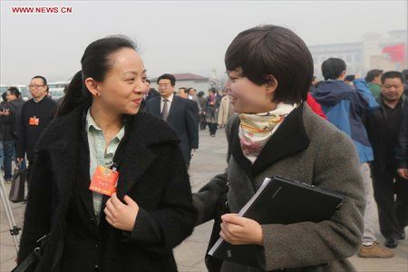 Tai Lihua (L), a member of the 12th National Committee of the Chinese People's Political Consultative Conference (CPPCC), arrives at the Tian'anmen Square to attend the second plenary meeting of the first session of the 12th CPPCC National Committee in Beijing, capital of China, March 7, 2013. Women's presence in China's politics has been increasing in recent decades. The number of female deputies to the 12th National People's Congress and members of the 12th National Committee of the Chinese People's Political Consultative Conference (CPPCC) rise to 699 and 399, reaching 23.4% and 18.4% of the total respectively. (Xinhua/Xing Guangli)