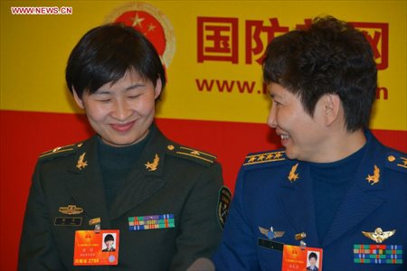 Chinese astronaut Liu Yang (L), a deputy to the 12th National People's Congress, reacts during an interview by Xinhua in Beijing, capital of China, March 7, 2013. Women's presence in China's politics has been increasing in recent decades. The number of female deputies to the 12th National People's Congress and members of the 12th National Committee of the Chinese People's Political Consultative Conference (CPPCC) rise to 699 and 399, reaching 23.4% and 18.4% of the total respectively. (Xinhua/Li Gang)