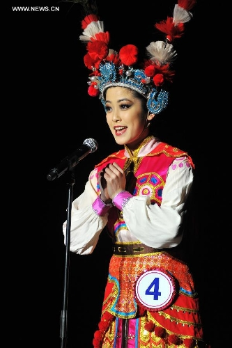 Leah Li, the winner of the Miss Chinatown U.S.A. Pageant 2013, performs during the rehearsal of the pageant in San Francisco, the United States, Feb. 15, 2013. The Miss Chinatown U.S.A. Pageant 2013 closed on Feb. 16. (Xinhua/Liu Yilin)
