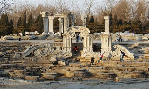 Amid the ruins of the Old Summer Palace, a symbol of national humiliation. Photo: CFP