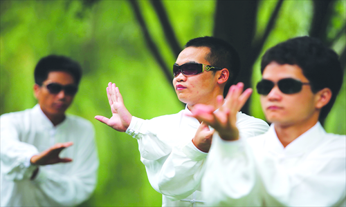 Blind students practice Tai Chi every morning at Master Wan's training center in Beijing. Photo: IC